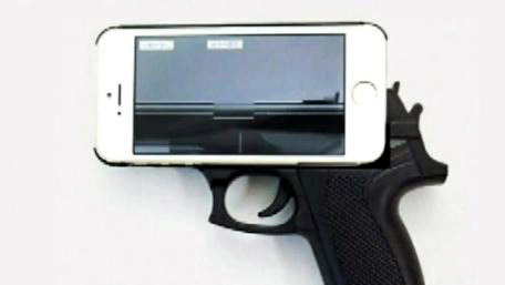 20190610014853-estuche-celular-forma-pistola-arma.jpg